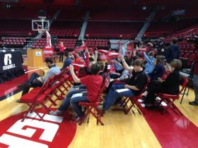 """Area school children attended Tuesday's news conference about the Jan. 8 """"Spread the Red Education Game."""""""