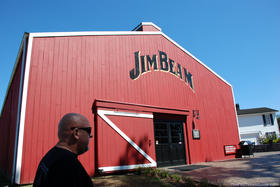 Visitors take a tour at the Jim Beam distillery in Clermont, Ky.