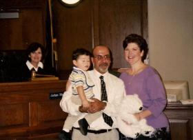 Judge Huddleston is seen in this 2004 photo of Michael and Denise Lambrianou with their 19-month-old adopted son Dakota.