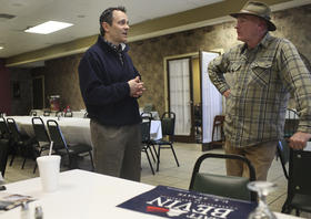 Republican U.S. Senate candidate Matt Bevin speaks with a citizen during a stop Thursday in Bowling Green.