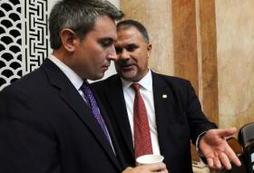 """John """"Bam"""" Carney (right) visits with Rep. Ryan Quarles in August, 2013."""