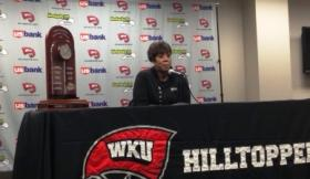 Head Coach Michelle Clark-Heard with the Sun Belt Conference trophy Wednesday