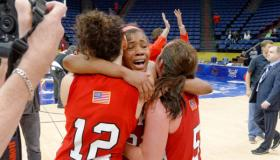 The Lady Toppers celebrate their win Saturday in the Sun Belt Conference championship game