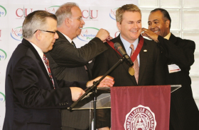 Agriculture Commissioner James Comer, second from right, is presented the Campbellsville University Leadership Award.