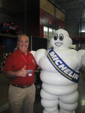 """Motorsports Park General Manager Mitch Wright poses with the """"Michelin Man."""""""