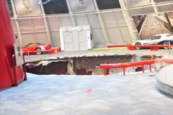 The sinkhole and the eight damaged cars will remain as-is through the end of August.  The museum celebrates its 20th anniversary with an event August 27-30.
