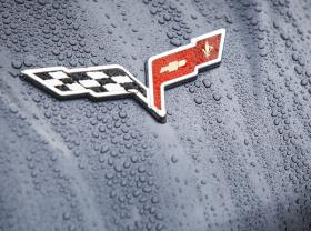 A Corvette logo glistens in the wet weather during the Corvette Homecoming outside the Sloan Convention Center in Bowling Green
