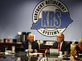 Tommy Elliot, chairman of the Board of Trustees, and Executive Director Bill Thielen listen to a presentation during the meeting of Kentucky Retirement Systems on May 15, 2014.