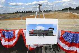 A rendering of the Holley Control Tower and Event Center sits in front of the stage at the NCM Motorsports Park in Bowling Green on Thursday, July 17, 2014.