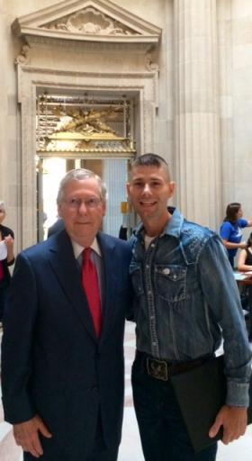 """U.S. Senator Mitch McConnell and America's Got Talent contestant Jimmy Rose, who sings a song called """"Coal Keeps the Lights On."""" Rose attended the EPA hearing as a guest of McConnell."""