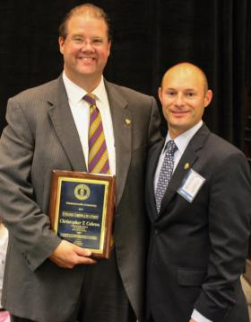 Chris Cohron (left) receives the 2014 Outstanding Commonwealth's Attorney Award from Assistant Deputy Attorney General Mitchel Denham.