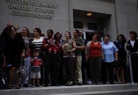 Several families invested in the cases gathered outside after arguments were heard.