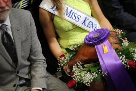 Miss Kentucky displays the record-breaking country ham Thursday morning at the State Fair