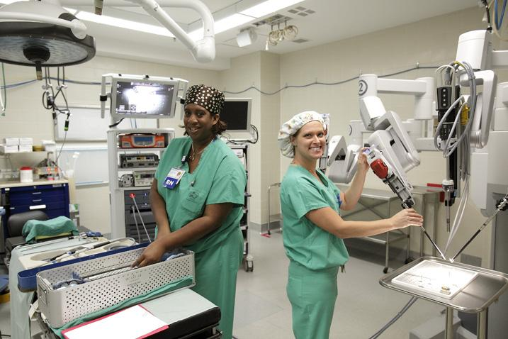 Two nurses prep the da Vinci surgical system at Owensboro Medical Health System.