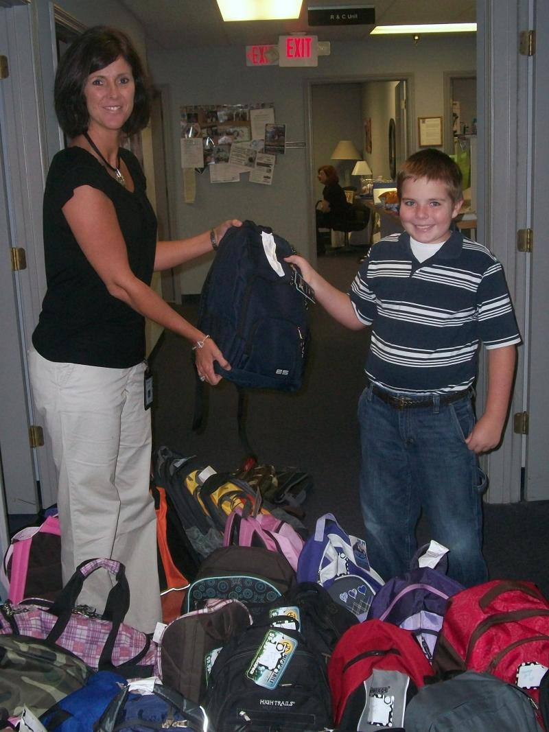 Noah Jones drops off donated bags at the Department for Protection and Permanency in Bowling Green.