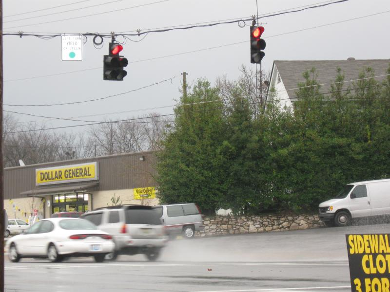 Two unidentified Bowling Green drivers run a red light at the same time.