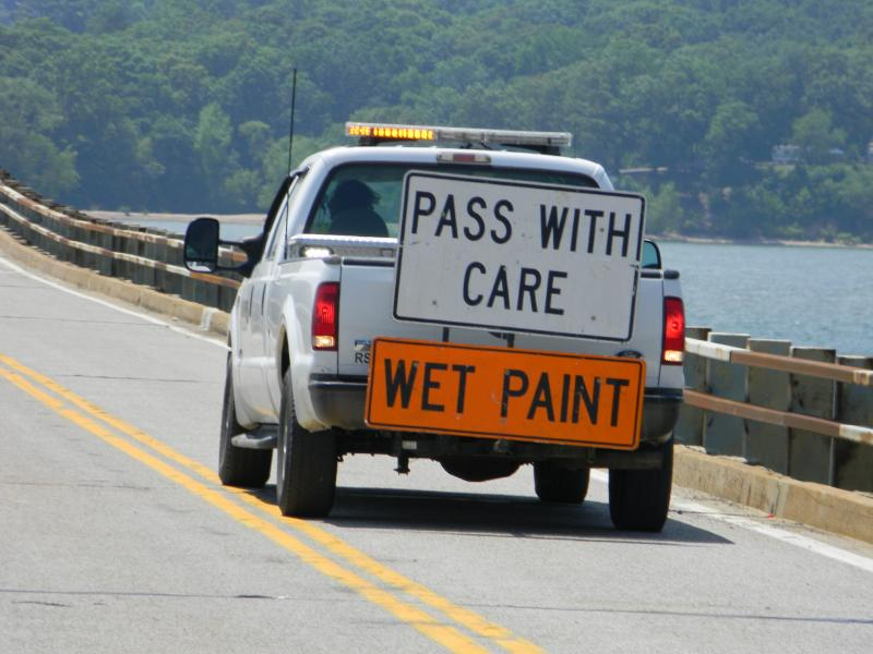 A paint truck adds center line stripes to the Eggners Ferry Bridge Replacment Span
