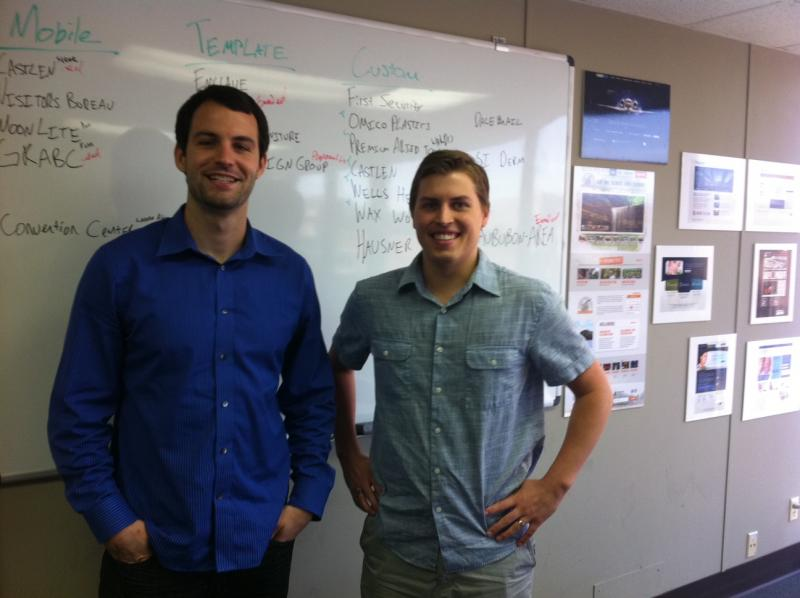 Nathan Cruse (left), and Nick Knapp in the Owensboro office of VE Creative