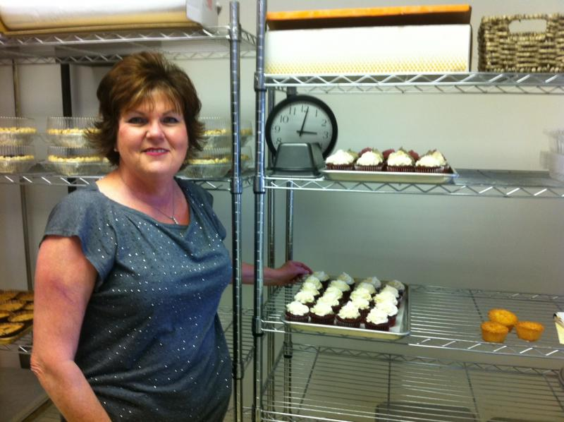 Nancy Faulkner in front of some of her cooling racks at Gluten Free Goodies in Owensboro.