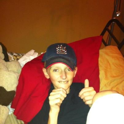 "In this Facebook photo, Lane gives his signature ""thumbs up."""