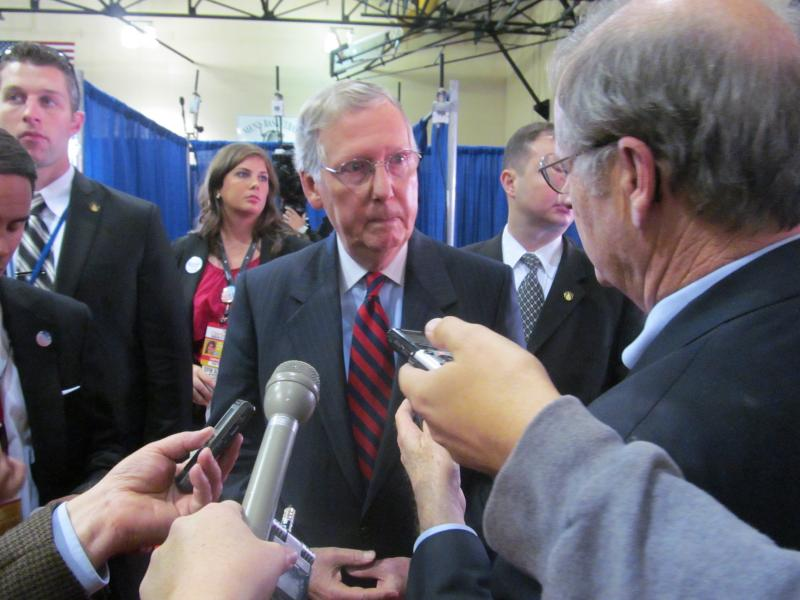 Senate Minority Leader Mitch McConnell talks with reporters after the VP debate