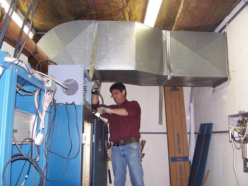 Engineer Erik Costa begins dismantling the ductwork.
