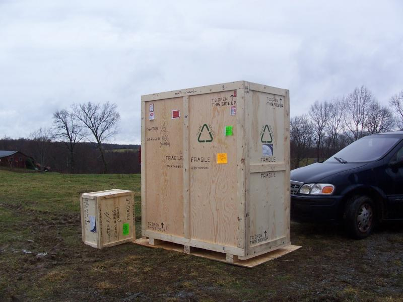 Here comes the new transmitter.  It needed to be uncrated outside to fit through the doorway.  Glad it stopped raining!