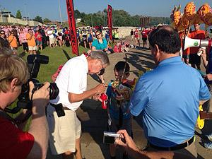 "Owensboro Mayor Ron Payne takes part in the traditional ""doting of the eye"" during opening ceremonies"