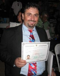 Elenodoros Hadjisaavva, a native of Greece, holds his citizenship certificate following the naturalization ceremony.  He lives in Henderson, KY with his wife Ellada, who became an official U.S. citizen three years ago.