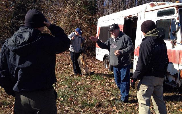 Gene England instructs officers at the Advance Canine Academy in Scottsville