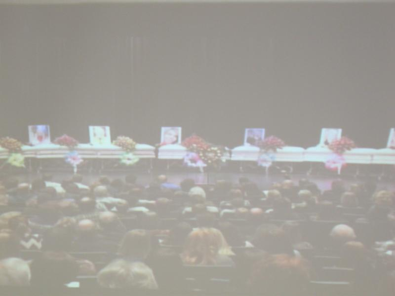 Nine caskets are lined up in the auditorium of Muhlenberg County High School.