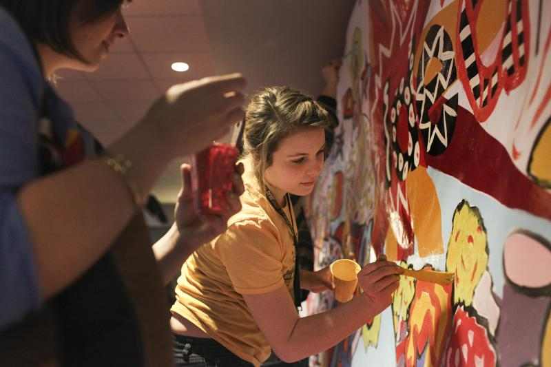 Megan Meredith, Art Education Major at WKU, paints part of the mural during IdeaFest at WKU on February 28, 2014.
