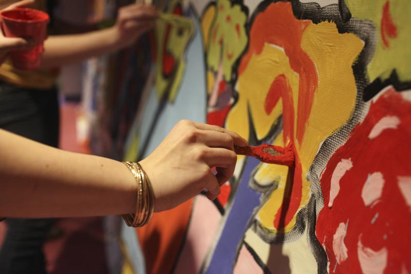 Participants paint a mural at the IdeaFest at WKU on February 28, 2014.