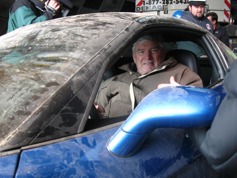 Museum Director Wendall Strode proudly sat in the ZR-1 after its removal from the sinkhole.