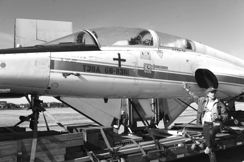 Fawn M. Quick poses next to the T-38 Talon NASA jet at the Bowling Green Airport on March 22, 2014.