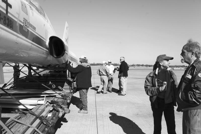 Pilots and friends check out the T-38 Talon NASA jet at the Bowling Green Airport on March 22, 2014.