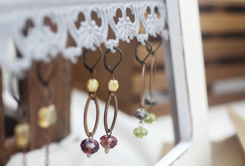 Melissa Jolly of the Jolly Emporium makes earrings that she sells at the Community Farmers Market.