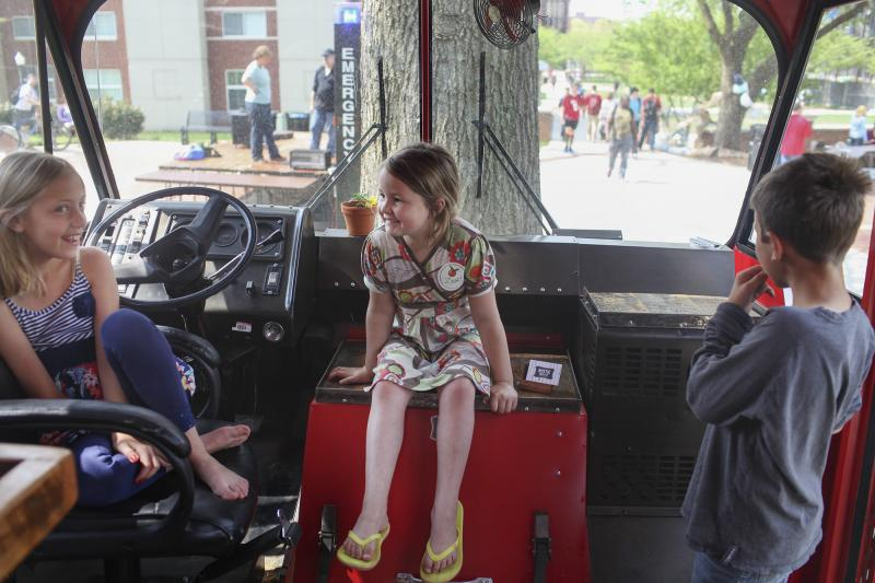 Maggie Jolly, 9 (left) and Eliza Beth, 7, and Carter Howell, 10, play in the mobile farmers market on WKU's campus on Earth Day, Tuesday, April 22, 2014