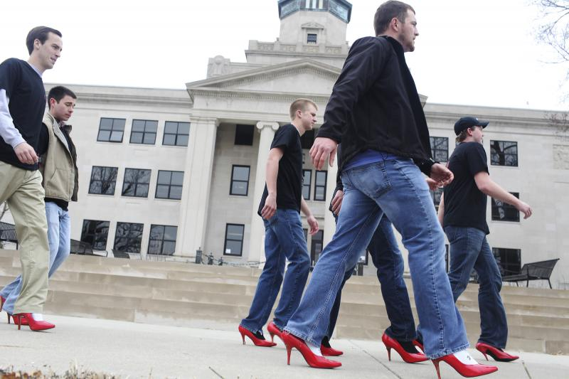 Dozens of male WKU students and faculty walked a mile around WKU's campus for Walk a Mile in Her Shoes to bring awareness to sexual assault on Tuesday, March 18, 2014.