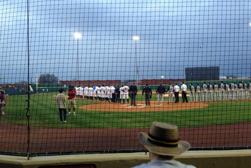 The Hot Rods and South Bend Silver Hawks line up for the national anthem Thursday night