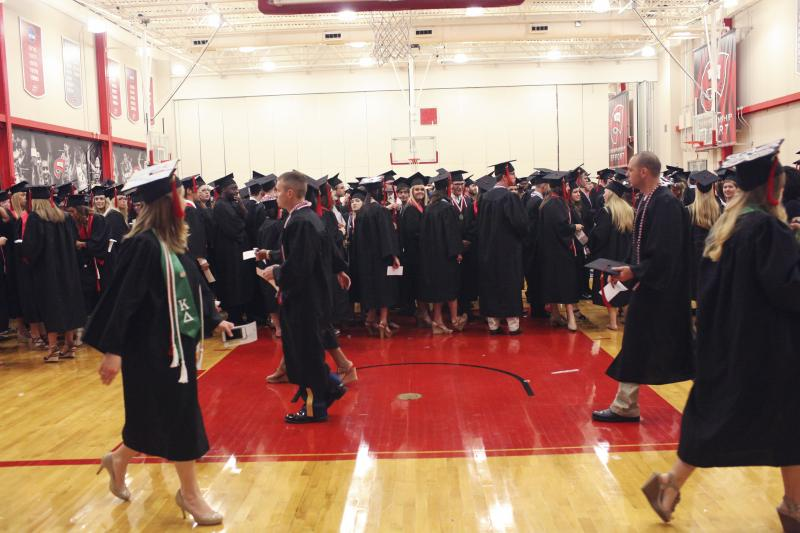 WKU graduate candidates prepare for commencement in the auxiliary gym at Diddle Arena on Saturday, May 17, 2014.