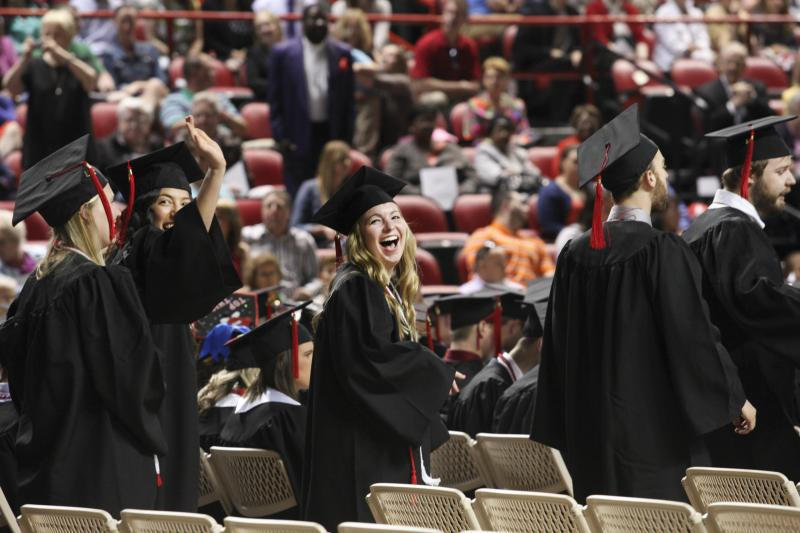 WKU graduate candidates file into Diddle Arena Saturday, May 17, 2014.