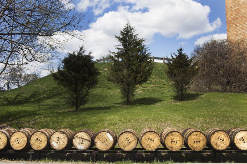 Empty barrels sit outside at the Woodford Reserve Distillery in Versailles, Ky on Wednesday, April 9, 2014.