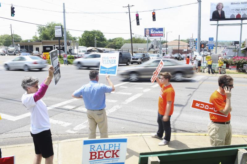 Candidates, friends and family hold signs at the corner of Scottsville Road and Nashville Road in Bowling Green on Tuesday, May 20, 2014.