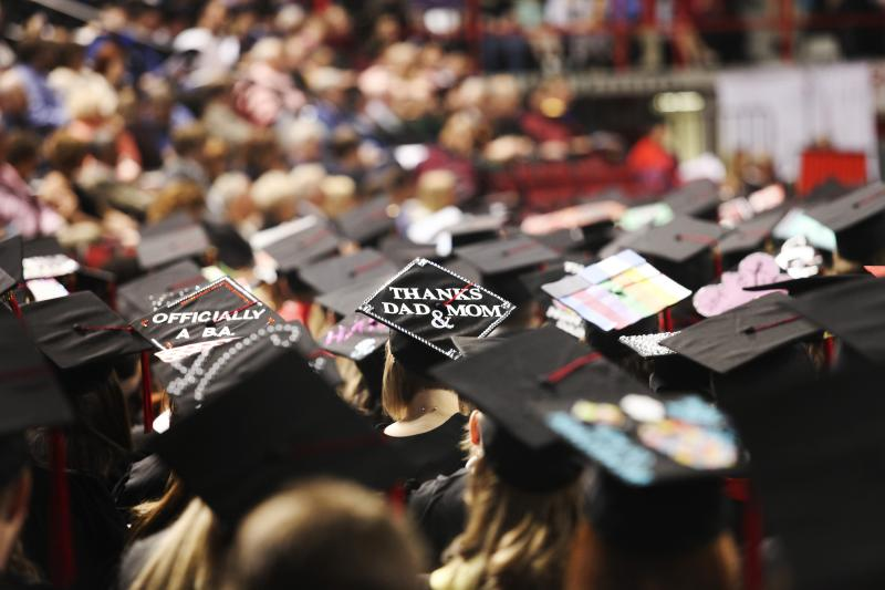 WKU graduate candidates wear decorated hats at their commencement cerimony at Diddle Arena on Saturday, May 17, 2014/