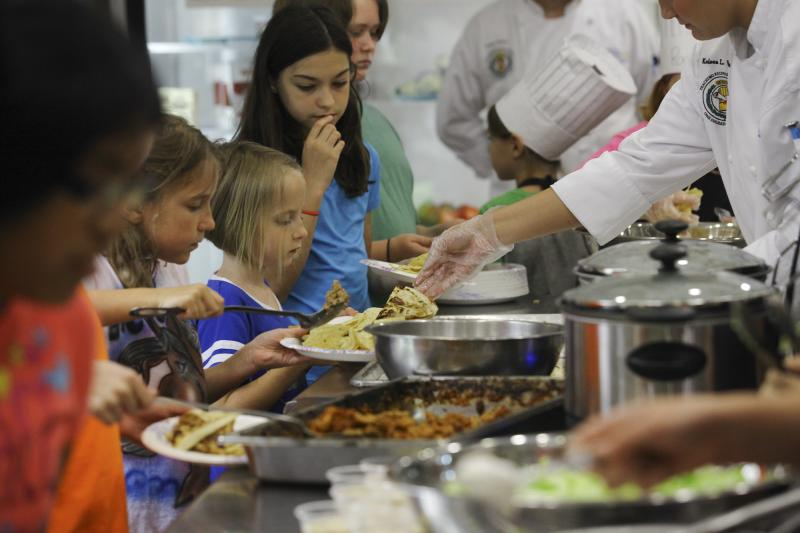 Campers serve each other during Chef Camp at Southcentral Kentucky Community and Technical College in Bowling Green on Friday, June 13, 2014.