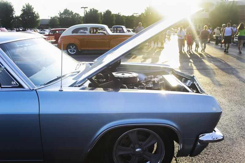 Vintage cars are lined up outside the Sloan Convention Center in Bowling Green for the public reception for the National Holley Hot Rods Reunion on Thursday, June 12, 2014.