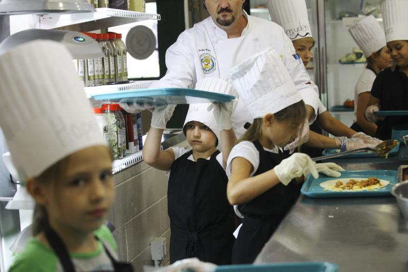 Campers prepare quesadillas during Chef Camp at Southcentral Kentucky Community and Technical College in Bowling Green on Friday, June 13, 2014.