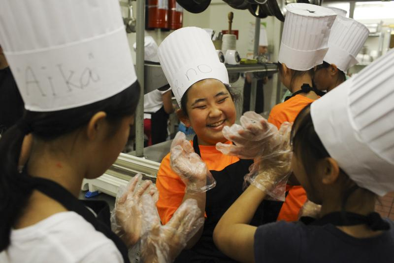 Rino Hotogi, 11, plays with her friends during Chef Camp at Southcentral Kentucky Community and Technical College in Bowling Green on Friday, June 13, 2014.