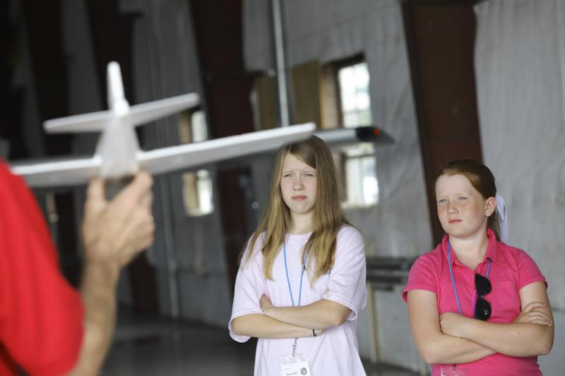 Hannah Ward (left), 13 of Smiths Grove, and Megan Jones, 11 of Bowling Green, observe Kurt Jefferson, aeronautics instructor from Lexingon, during Aviation Camp at the Bowling Green Regional Airport on Tuesday, July 8, 2014.